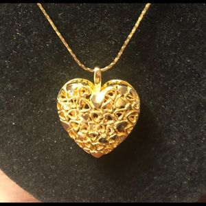 Jewelry - Large Gold Heart on 24 inch chain. New condition.